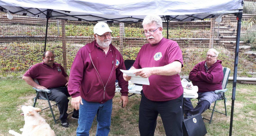 President Bob presenting Lions Pin to Lion Steve Lawrence for member sponsorship achievements